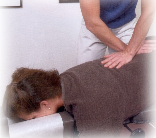 Woman Getting Chiropractic Adjustments